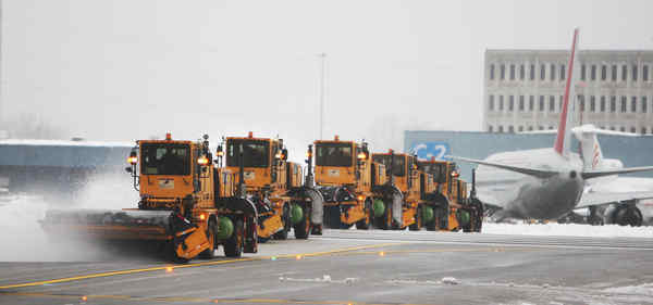 It took a convoy of snowplows to clear the runways at PHL on Feb. 10, at the end of the second major February snowstorm.