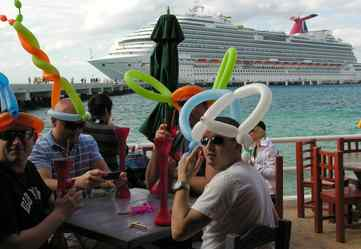 Passengers from the new Carnival Dream (background) stop for drinks at the Caribbean port of Cozumel.