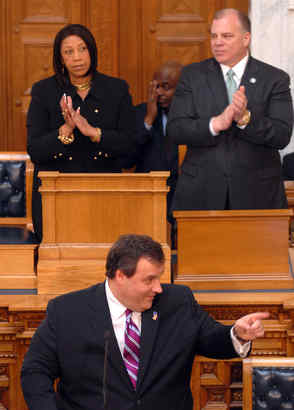 N.J. Gov. Chris Christie addresses the Legislature, applauded by Speaker Sheila Oliver and Senate President Stephen Sweeney.