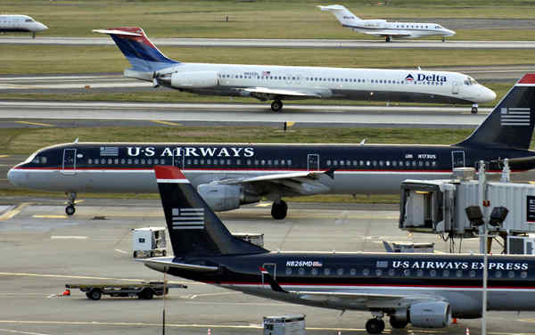 """Project runway: US Airways, Philadelphia´s dominant carrier, wants to """"knock all the kinks out"""" before fines go into effect."""