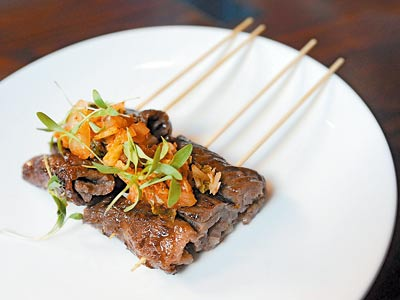 """... egg roll,"""" peking duck, tuna sashimi and, above, Korean bbq beef"""