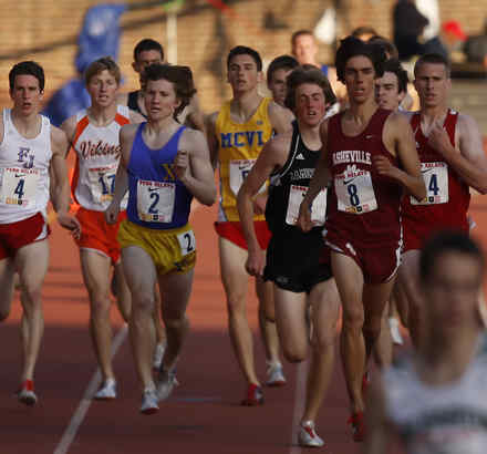 Father Judge´s Tom Kehl (left) runs alongside Perkiomen Valley´s Vince Perozze (17) with competitors from other schools in the boys´ mile run in the Penn Relays at Franklin Field.