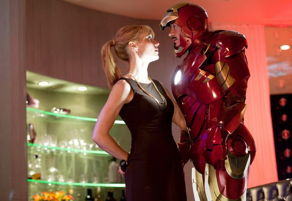 """Gwyneth Paltrow and Robert Downey Jr. in """"Iron Man 2."""" He plays Tony Stark, a superhero who is both a warmonger and a peacemaker. She plays Pepper Potts, the CEO of his arms company."""