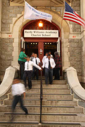 Students at Hardy Williams Academy exit through the front door during a recent fire drill. The charter school, founded in 1999, has more than 800 students in kindergarten through ninth grade.
