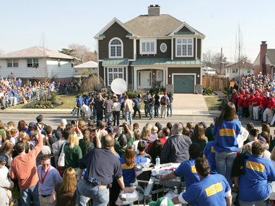 Hundreds of people show up in the Northeast to watch the taping of Extreme Makeover. Ty Pennington escorts the Py family into their new home at 9963 Haldeman Avenue. (David Swanson / Staff Photographer)