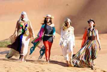 Walking on the sands of Abu Dhabi are, from left, Kim Cattrall, Kristin Davis, Sarah Jessica Parker and Cynthia Nixon.