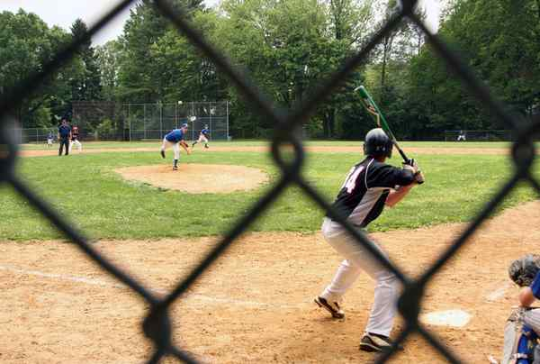 At Elwell Field in Haverford Township, Barrack Hebrew´s Daniel Saewitz delivers a pitch to Life Center´s Jonathan Wilkins.