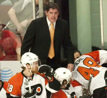 Coach Peter Laviolette , reacting to the injury to Danny Briere´s face in Game 5, has been a steady force behind the bench for the the Flyers.