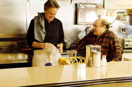 Michael Douglas (left), with Danny DeVito as an old college acquaintance, stars as an aging, sexually exploiting - but engaging - salesman.
