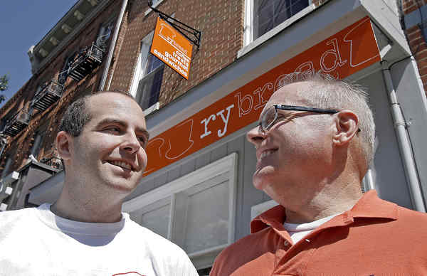 Ryan (left) and Dennis Pollock, son and father, at Rybread, a coffee/sandwich shop fulfilling a need and a vision.