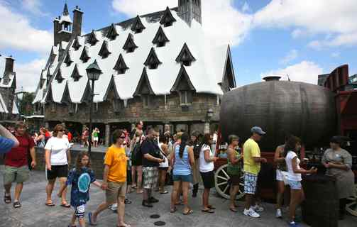 Visitors wait in line for butterbeer at Hogsmeade Village, part of the Wizarding World of Harry Potter.