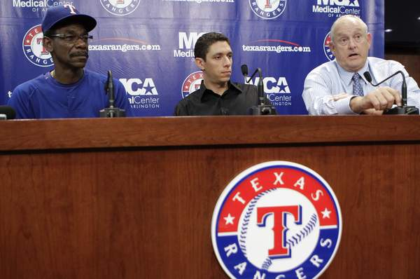Texas manager Ron Washington (left), GM Jon Daniels, president Nolan Ryan discuss Cliff Lee trade.