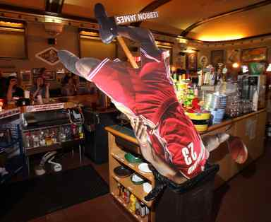 A cardboard standup of LeBron James is consigned to the wastebasket in this Cleveland restaurant after James announced he was going to Miami.