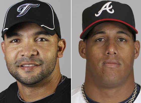 Atlanta acquired shortstop Alex Gonzalez (left) and sent Yunel Escobar to Toronto.