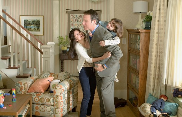 Sisters Beezus (left, Selena Gomez) and Ramona (Joey King) share an enthusiastic embrace with their father John Quimby (John Corbett).