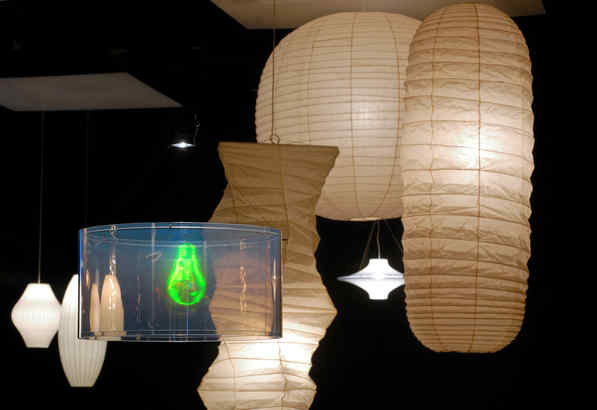 "In the ""Hanging Around"" show: Hologram lamp by Maurer (front); ""Bubble"" lamps by George Nelson (left); ""UFO"" lamp by Yki Nummi (rear right); Akari lamps by Noguchi."