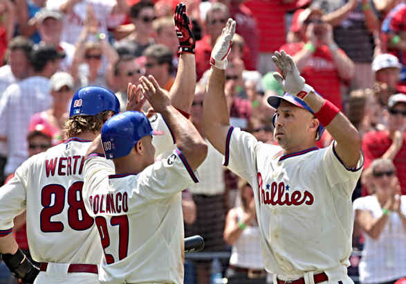 Phillies leftfielder Raul Ibanez (right) is welcomed at home plate by Jayson Werth and Placido Polanco after hitting a three-run homer in the Phillies´ five-run third inning.