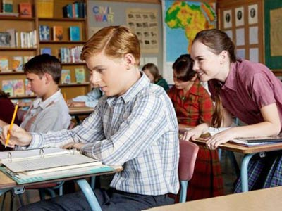 Callan McAuliffe as Bryce and Madeline Carroll as Juli in &quot;Flipped.&quot; Most of the movie unfolds while the two are in eighth grade, back in 1963. (Warner Bros. Pictures)