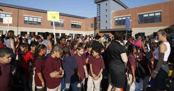 Students, relatives and teachers gather in the schoolyard at  Willard Elementary School in Kensington in 2010.
