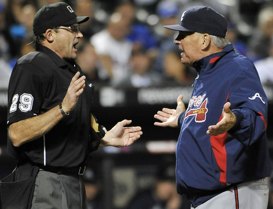 Braves manager Bobby Cox (right) argues with umpire Bill Hohn before being ejected.