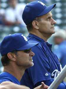 Joe Torre (right) is done after this season as Dodgers manager. Don Mattingly (left) steps in for 2011.