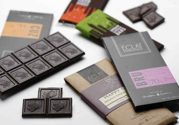 From Éclat Chocolate of West Chester, 70 percent cacao bars and, rear, Urban Garden Bars from John & Kira's, the socially conscious North Philadelphia chocolatier.