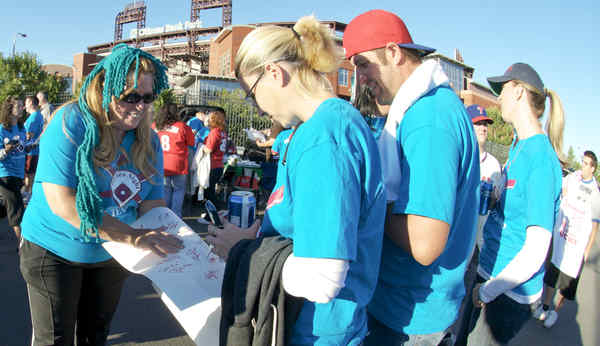 Supporters of Lisa Loonstyn gather to raise awareness of ovarian cancer yesterday outside Citizens Bank Park. Loonstyn, 22, threw out the ceremonial first pitch at the Phils game last night.