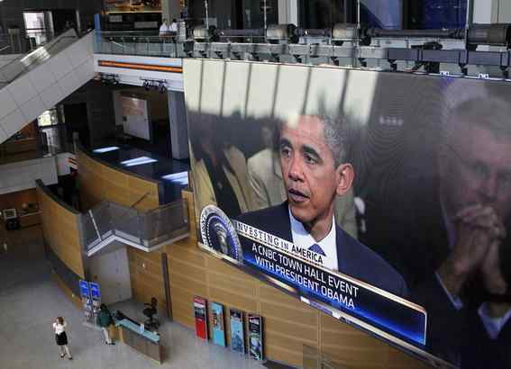 President Obama was displayed on a large video screen at the Newseum in Washington, during Monday´s talk on jobs and the economy at a town hall-style gathering hosted by CNBC.