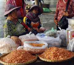 Cambodian vendors sell shrimp and other seafood at the Crab Market in Kep on the Gulf of Thailand.