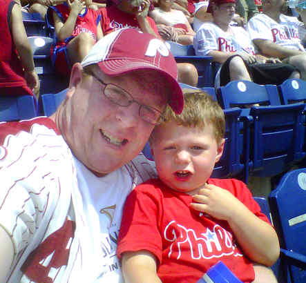 Christopher Whalen, 3, from Hamilton, N.J., takes in his first Phillies game this summer with his dad, Chris.