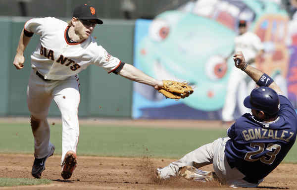 The Padres´ Adrian Gonzalez avoids a tag at second base from the Giants´ Mike Fontenot in a game San Diego had to win to have any hope of making the playoffs.