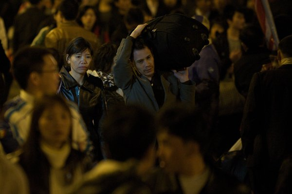 "Chen Suqin and Zhang Changhua at the Guangzhou railway station in a scene from ""Last Train Home."" They see their children only once a year."