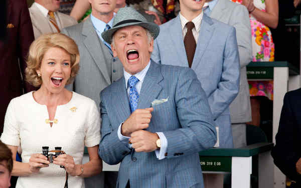 "Diane Lane and John Malkovich in a racetrack scene from ""Secretariat."" She plays the stallion´s owner, he its trainer."