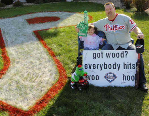 Joe Hipp, a Tinicum Township native, and daughter Emma Jane, 2, rooting for Phils from Milwaukee.