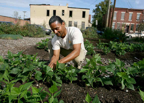 Pedro Rodriguez works a garden on Beckett Street. Gardens provide much-needed fresh food, a tool for fighting obesity in Camden´s children.
