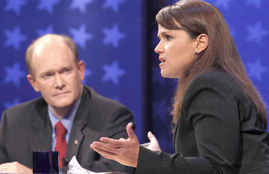 Republican Christine O´Donnell answers a question in Delaware´s senatorial debate as her Democratic opponent, Chris Coons, listens. The 90-minute face-off was carried on CNN.