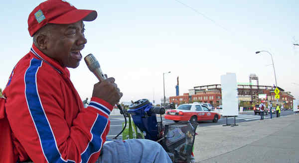 Sonny Forriest Jr. croons for fans yesterday outside the Bank.