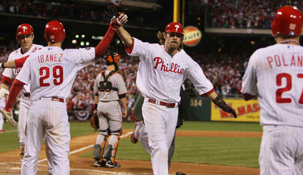 Raul Ibanez congratulates Jayson Werth after he scored on Jimmy Rollins´ double along with Chase Utley and Placido Polanco.