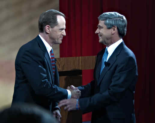 Pat Toomey (left) and Joe Sestak shake hands before a debate that became far less friendly.