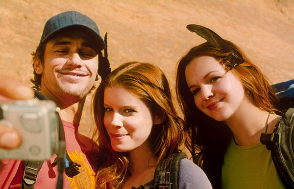 James Franco as Aron Ralston, the outdoorsman trapped by a boulder, with Kate Mara and Amber Tamblyn.