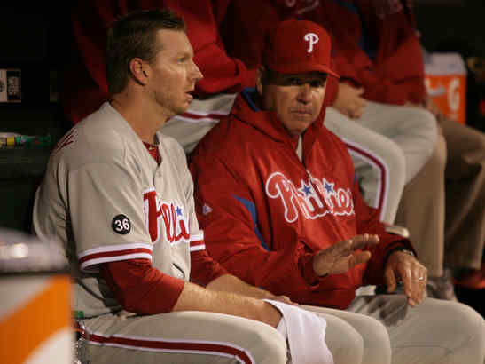 Roy Halladay talks with pitching coach Rich Dubee between the seventh and eighth innings. He went six innings, allowing two runs on six hits. He walked two and struck out five batters.