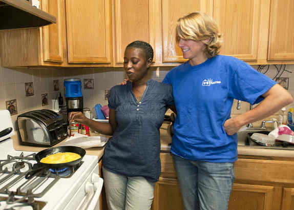 "Imani Sullivan (left) struggles to feed her family. Mariana Chilton, a Drexel child-hunger expert, helps her. ""If you really want to treat hunger,"" Chilton said, ""you have to make sure that every poor child has the same opportunity as every other child."""