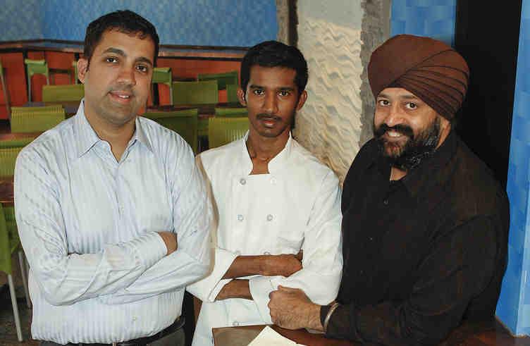 Philadelphia Chutney Company owner Nirav Mehta (left), with executive chef Lokesh (center) and partner Baldev Singh (right).