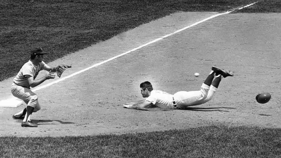 Pete Rose takes a headfirst slide in 1970. Ten years later,he helped the Phillieswin a world championship.