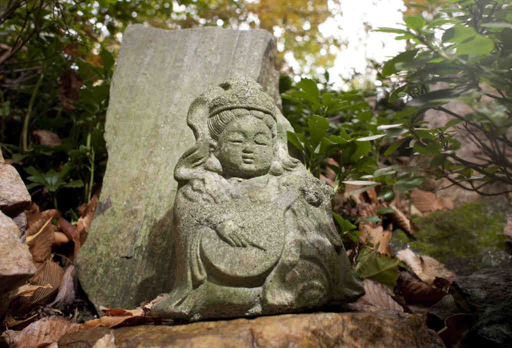 """A statue and a monolith in Charlie Dagit´s Japanese garden: """"A spirit of sacredness . . . oneness with nature."""""""