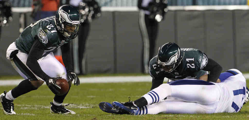 With Colts receiver Austin Collie out cold , the Eagles´ Quintin Mikell grabs the ball. Mikell was mistakenly penalized for the hit.
