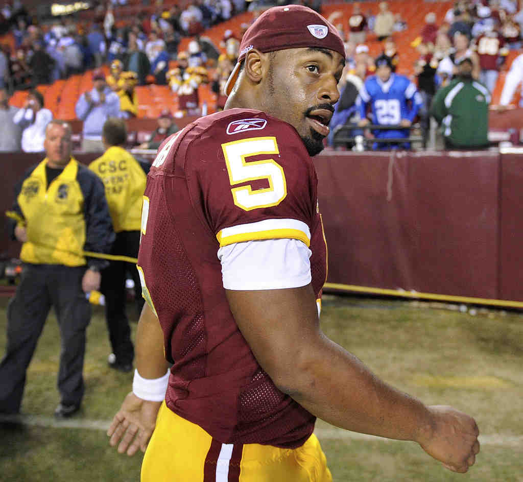 A critic of Donovan McNabb´s benching says Redskins coach Mike Shanahan used racial code words to explain the move.