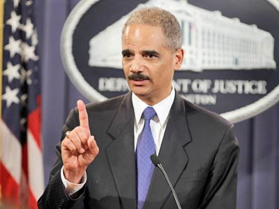"Attorney General Eric Holder answers a question about WikiLeaks during a news conference Monday at the Justice Department in Washington. ""This is not saber-rattling,"" Holder said. (AP Photo/Charles Dharapak)"
