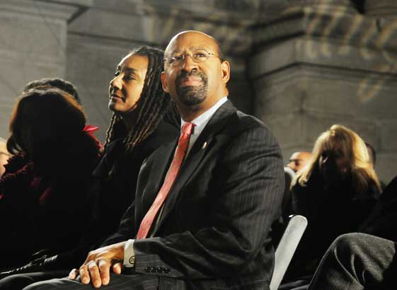 Mayor Michael Nutter looks up at the city´s Christmas tree during the tree lighting ceremony. Philadelphia´s tree lighting ceremony took place this afternoon outside City Hall.  December 2, 2010  (Sarah J. Glover / Staff Photographer)