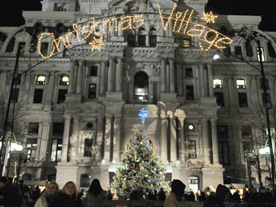 "Philadelphia´s Christmas tree sits below the ""Christmas Village"" sign - with the word ´Christmas´ restored - after removal of the word Monday caused a public outcry. Mayor Nutter led a tree lighting ceremony Thursday evening. (Sarah J. Glover / Staff Photographer)"